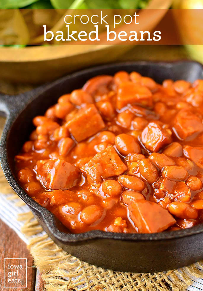 crock pot baked beans in a cast iron skillet