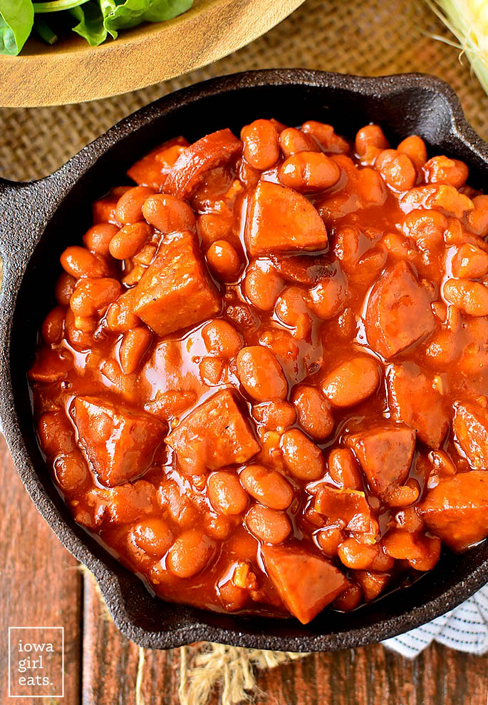 overhead photo of crock pot baked beans in a cast iron skillet