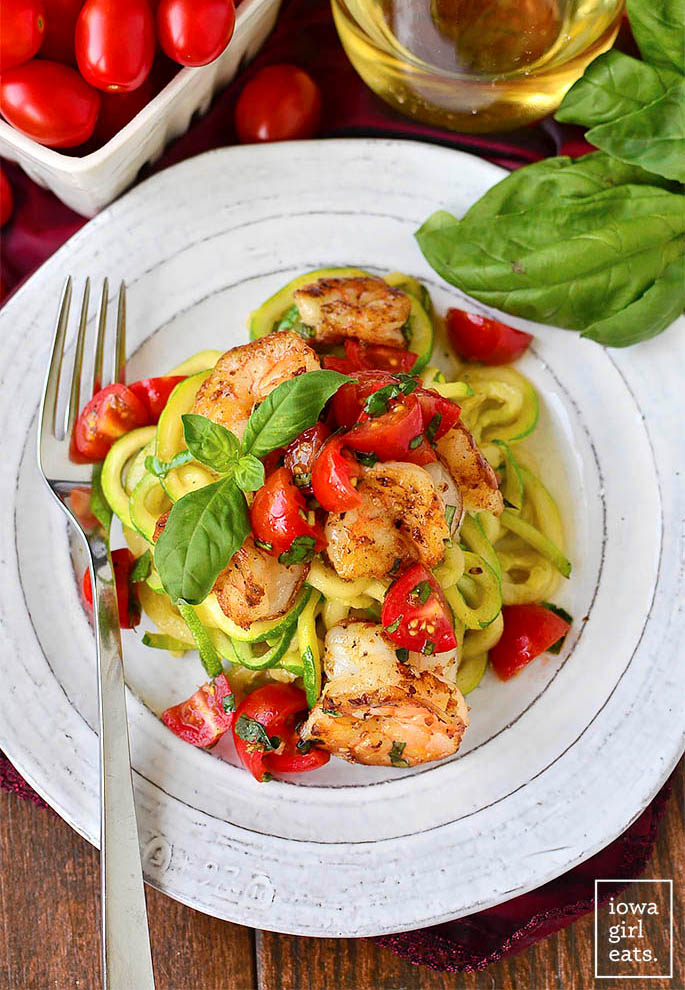 overhead photo of zoodles with tomato basil and shrimp