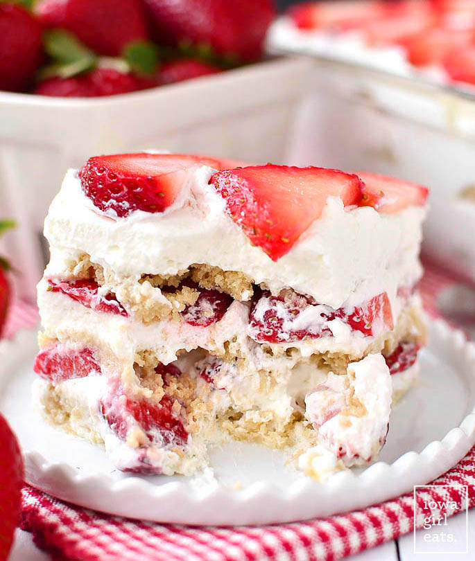 A piece of Gluten Free Strawberry Shortcake Icebox Cake cut into on a plate