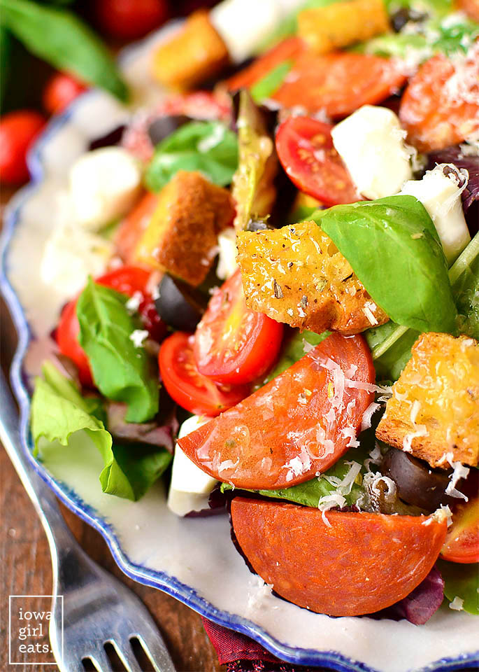 Close up photo of a plate of pizza salad