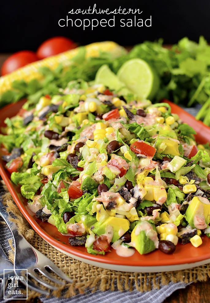Southwestern Chopped Salad is a party on a platter! Filling, fresh, and colorful, this gluten-free entree salad recipe will liven up your dinner table. | iowagirleats.com