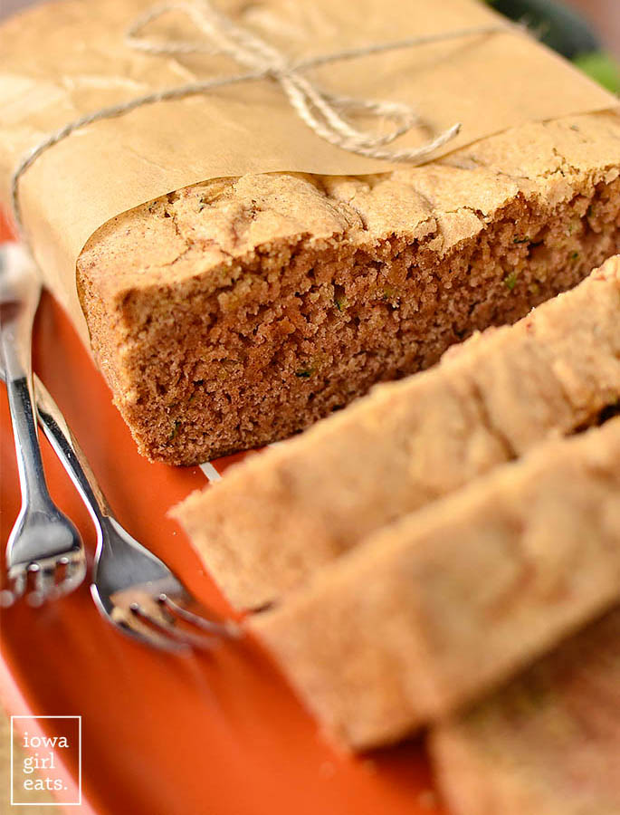 close up photo of a loaf of gluten free zucchini coffee cake with forks