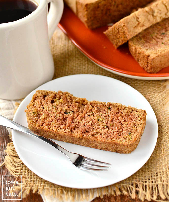 slice of gluten free zucchini coffee cake on a plate with a fork