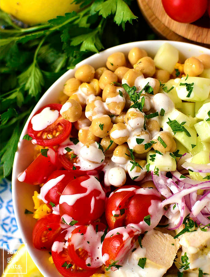 overhead photo of mediterranean chicken and chickpea bowl