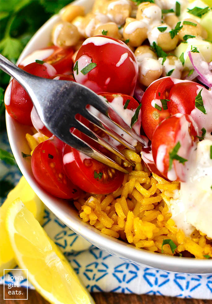 fork getting a bit of yellow rice from a bowl