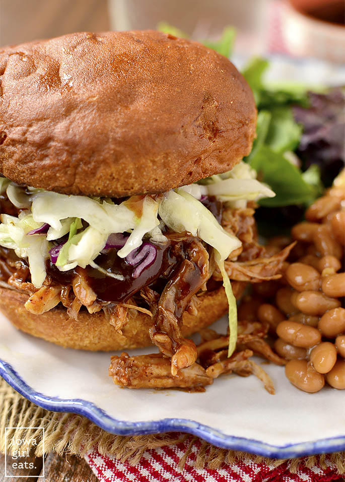 Crock Pot BBQ Pulled Pork is a long cooking crock pot recipe that couldn't be simpler. Use the pulled pork in sandwiches, or for nachos, salads, and wraps! #glutenfree | iowagirleats.com