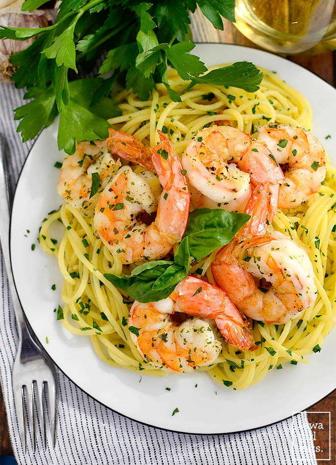garlic herb butter pasta with roasted shrimp on top