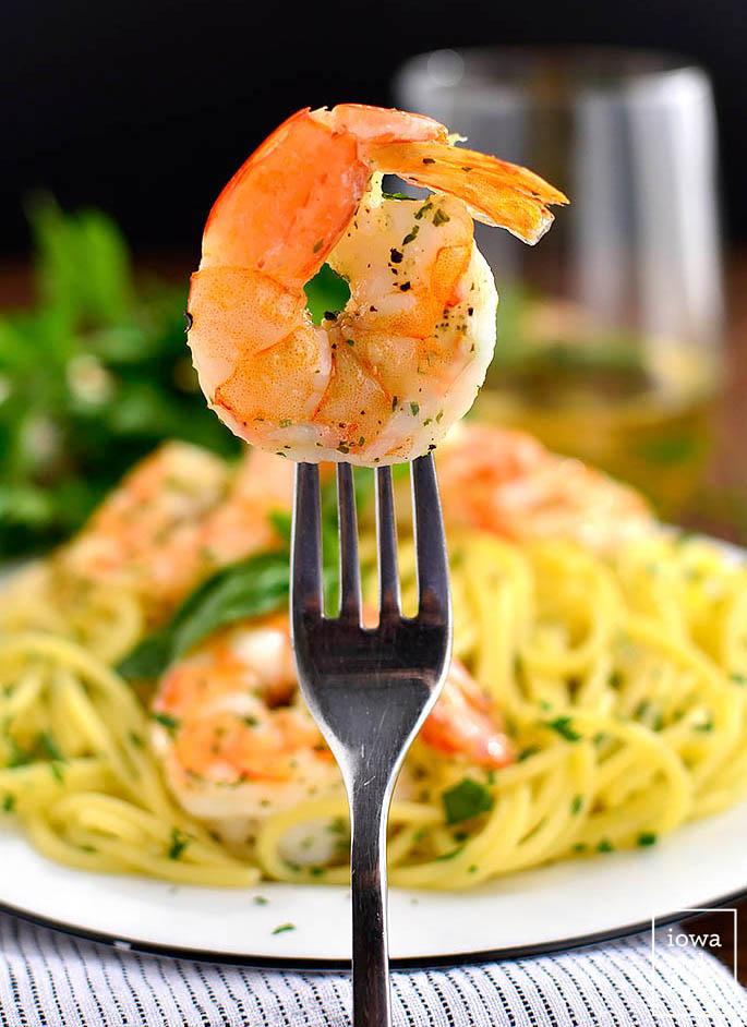 fork spearing a roasted shrimp