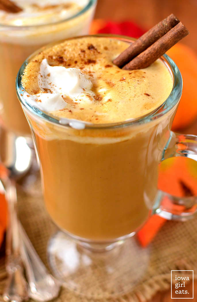 glass of homemade pumpkin spice latte with whipped cream