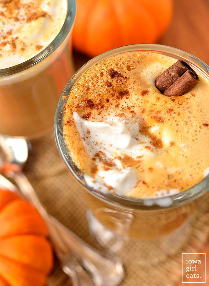glass of homemade pumpkin spice latte with whipped cream and cinnamon