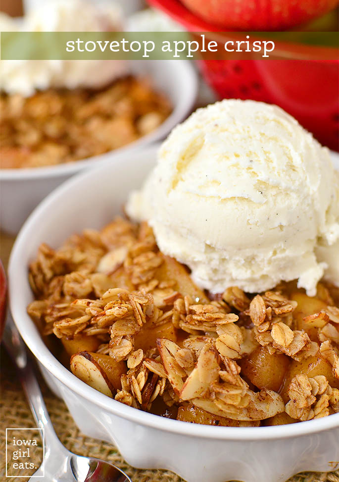 stovetop apple crisp in a bowl with ice cream