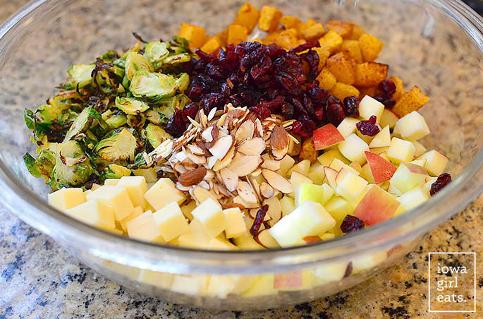 ingredients for wild rice harvest bowls in a mixing bowl