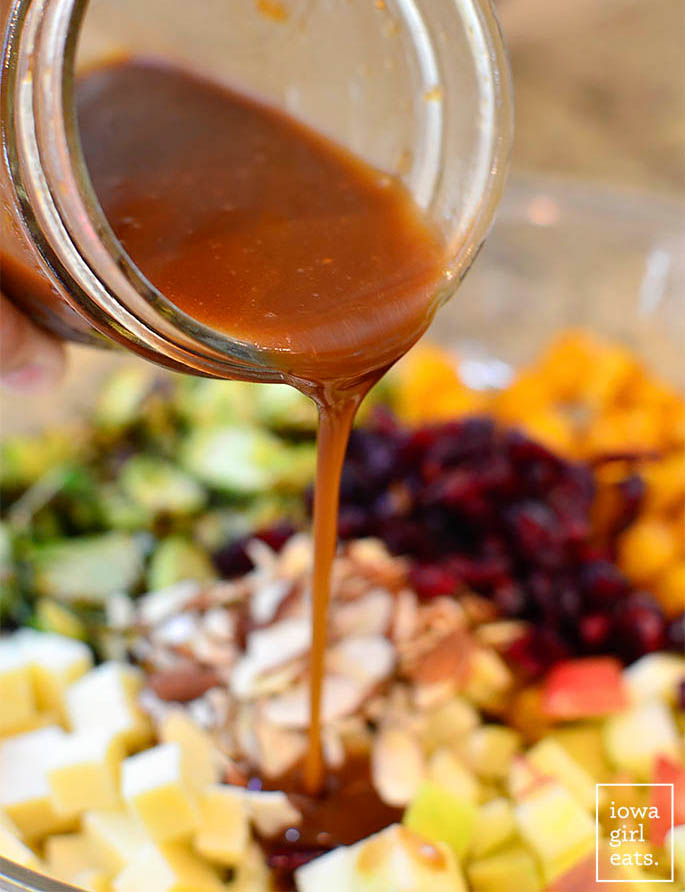 fig balsamic vinaigrette being drizzled over a salad