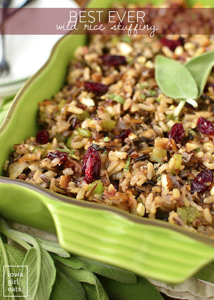 Best Ever Wild Rice Stuffing is full of fall flavors like herbs, bacon, mushrooms, parmesan, dried cranberries, almonds, and garlic. A delicious side for the holidays! | iowagirleats.com