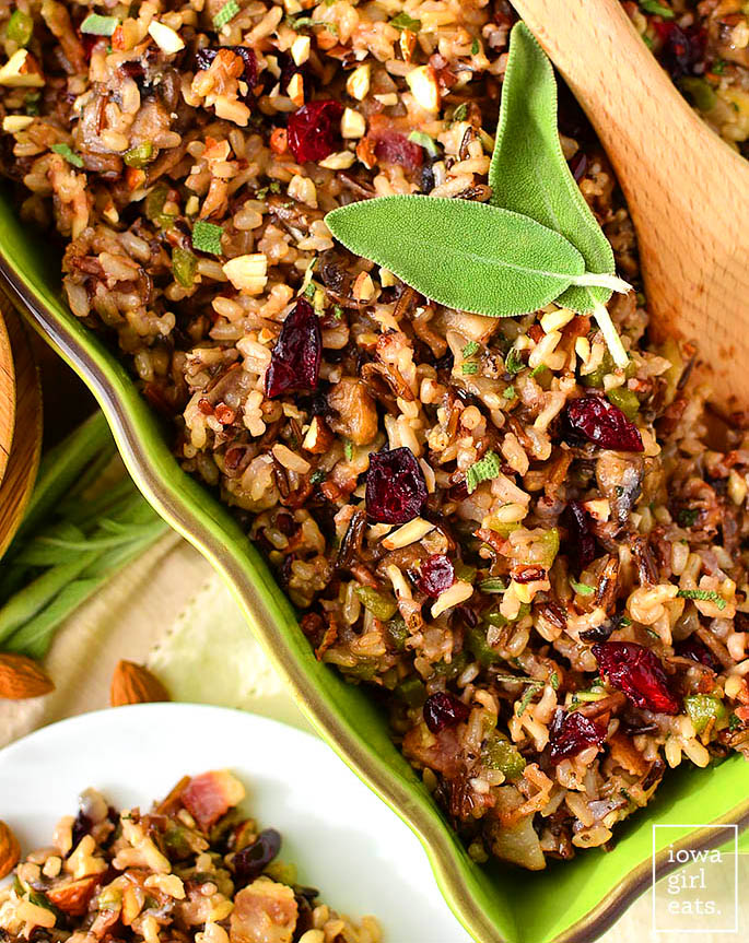 wild rice stuffing in a baking dish with fresh sage on top
