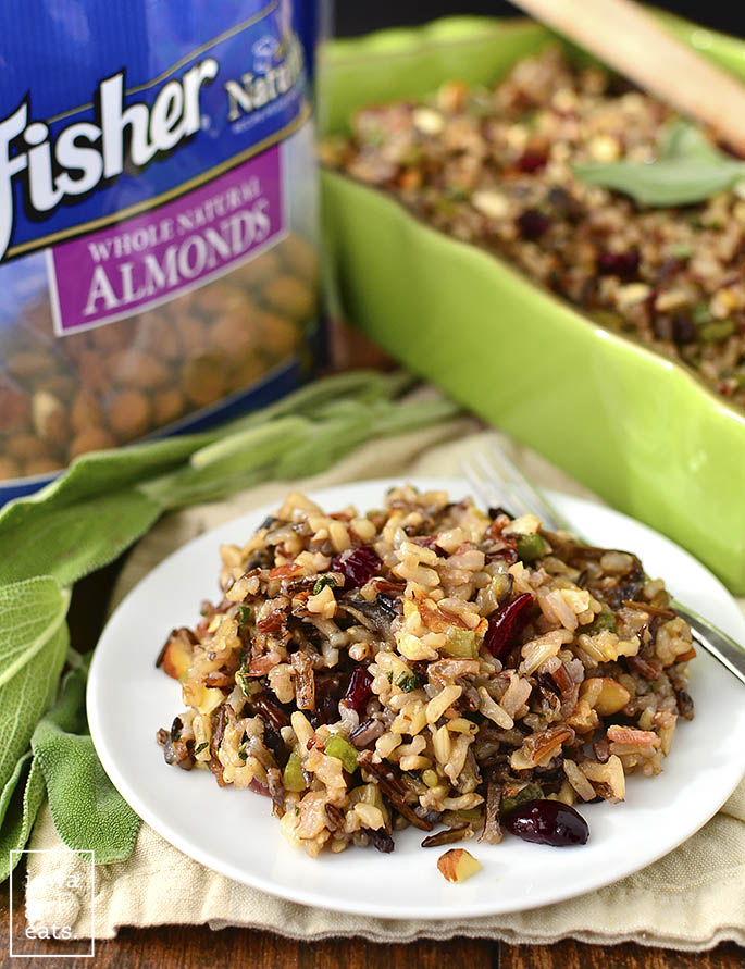 Best Ever Wild Rice Stuffing is full of fall flavors like herbs, bacon, mushrooms, parmesan, dried cranberries, almonds, and garlic. A delicious side for the holidays!   iowagirleats.com