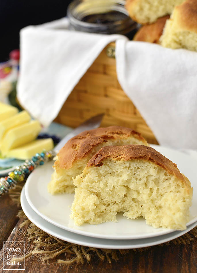 soft and chewy gluten free dinner rolls on a plate