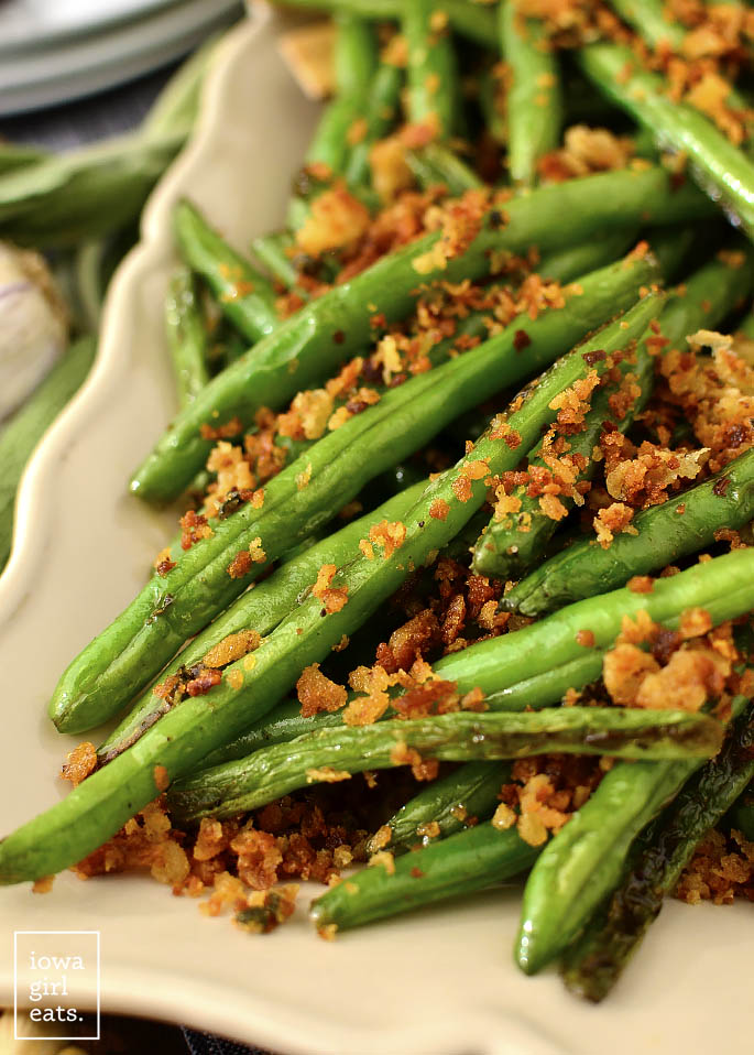 Green Beans with Brown Butter Garlic-Sage Breadcrumbs are made in 1 skillet and in 20 minutes. Serve as a beautiful and flavorful, gluten-free holiday side dish! | iowagirleats.com