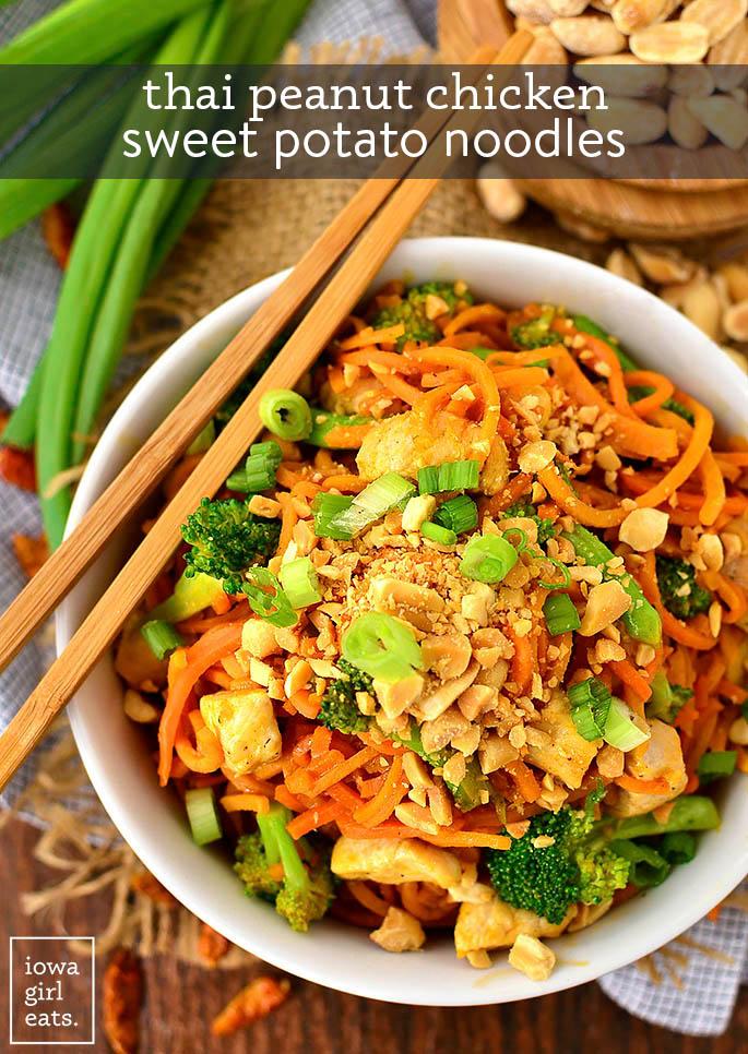 thai peanut chicken sweet potato noodles in a bowl with chopsticks