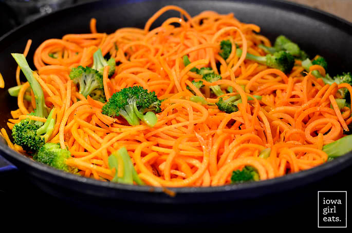 hot skillet with sweet potato noodles and broccoli florets