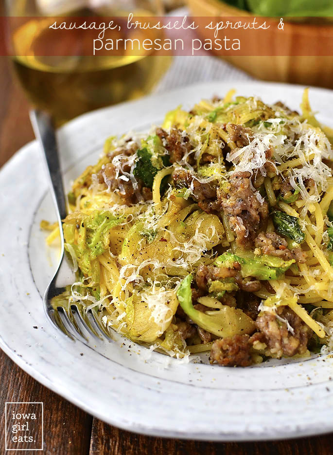 20 Minute Sausage, Brussels Sprouts and Parmesan Pasta will be on the table in absolutely no time. A filling and flavorful gluten-free dinner recipe!   iowagirleats.com