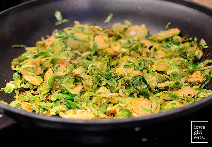 brussels sprouts sauting in a skillet