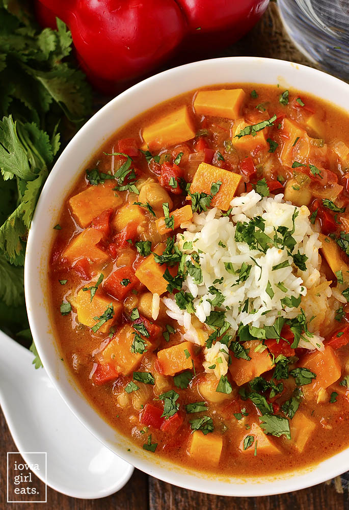 Senegalese Soup is chock-full of sweet potatoes, chickpeas, warming curry and coconut milk. A healthy, gluten-free soup recipe that's delicious and filling! | iowagirleats.com