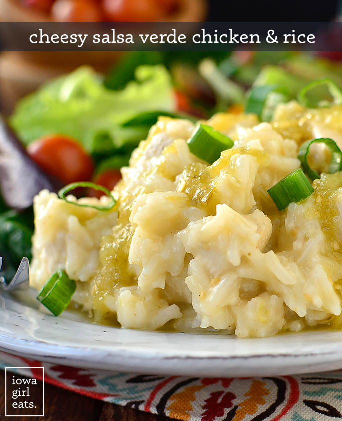 big scoop of cheesy chicken and rice on a plate topped with green onions
