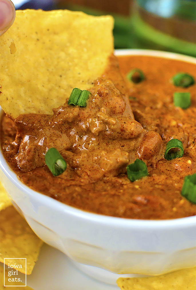 Crock Pot Cheesy Beef and Bean Enchilada Dip is a delectable gluten-free dip that's cheesy and savory. Perfect for game day or parties! | iowagirleats.com