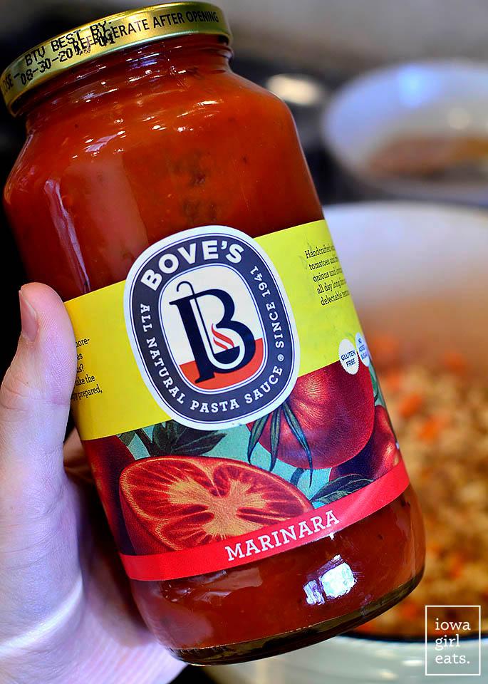 hand holding a jar of bove's marinara sauce