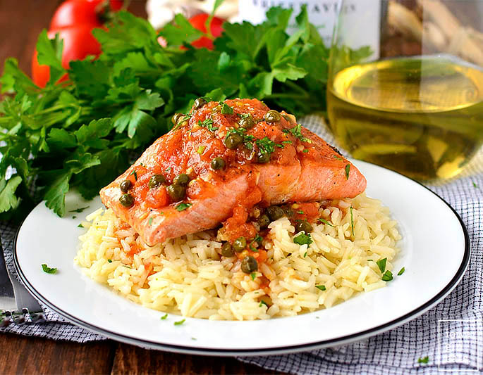 beautiful filet of cooked salmon over a bed of rice