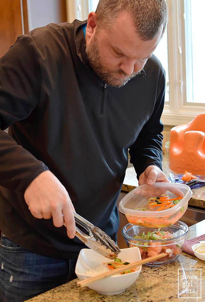 man making a poke bowl