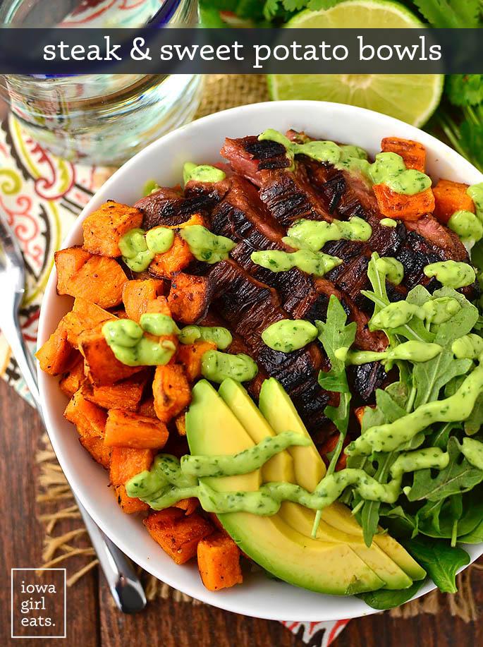 overhead photo of steak and sweet potato bowls with avocado cilantro drizzle