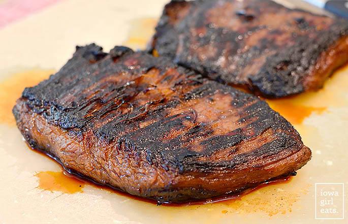 Grilled flank steak on a cutting board