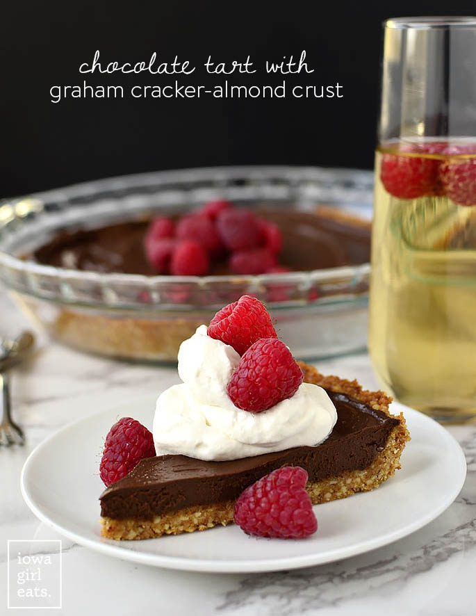 Chocolate Tart with Graham Cracker-Almond Crust is an unbelievably simple yet impressive gluten-free, dairy-free-friendly dessert recipe. Perfect for entertaining! | iowagirleats.com