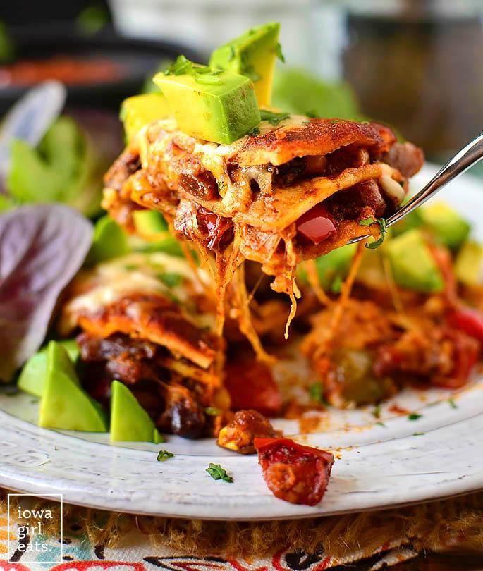 fork taking a bite of vegetarian enchilada stacks
