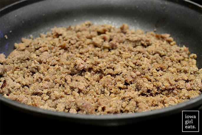 breakfast sausage browning in a skillet