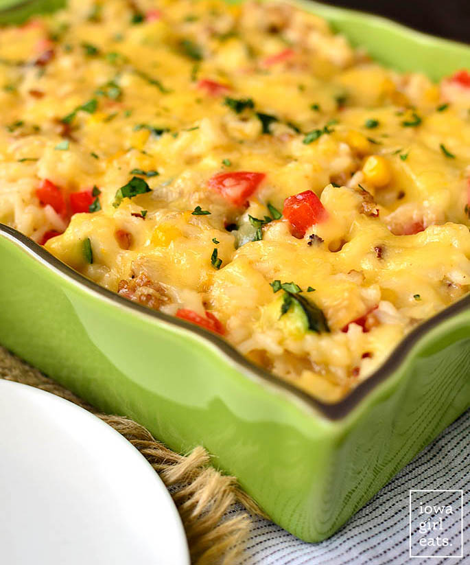 cheesy vegetable sausage rice casserole in a baking dish