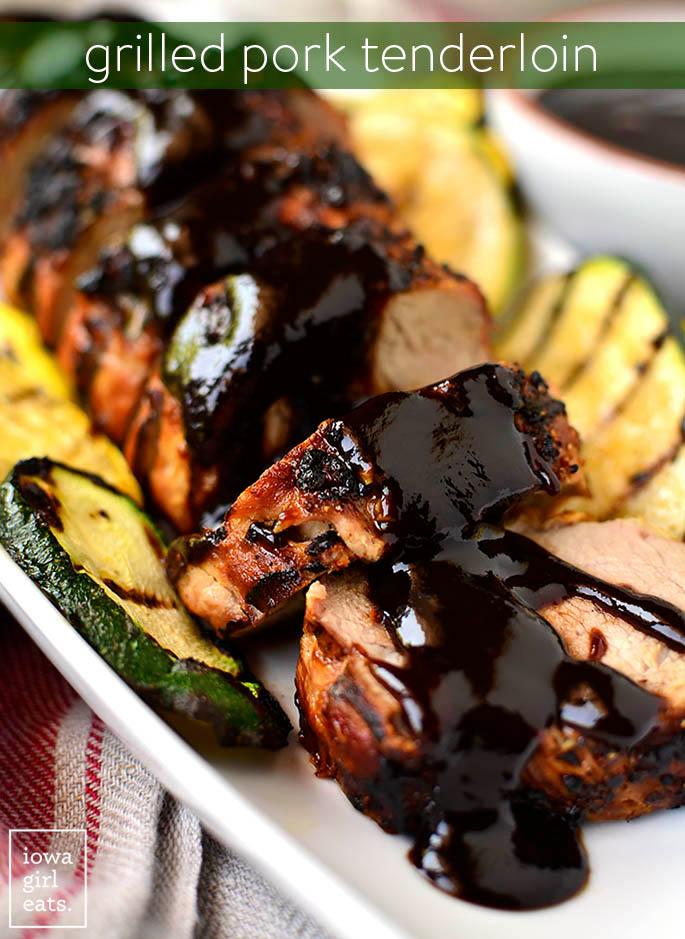 grilled pork tenderloin sliced on a platter