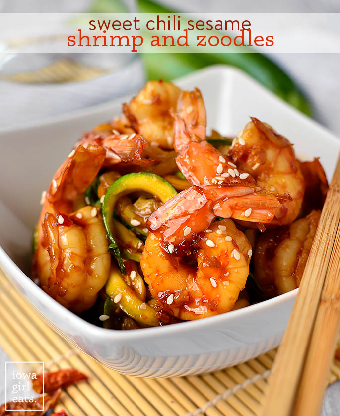 sweet chili sesame shrimp and zoodles in a bowl with chopsticks