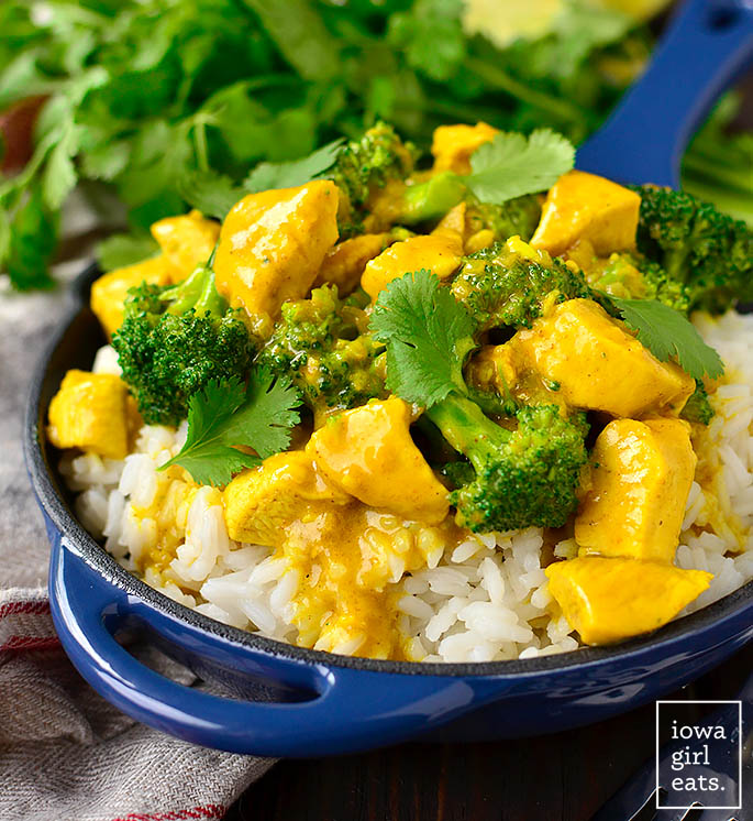 coconut chicken curry scooped over cooked white rice