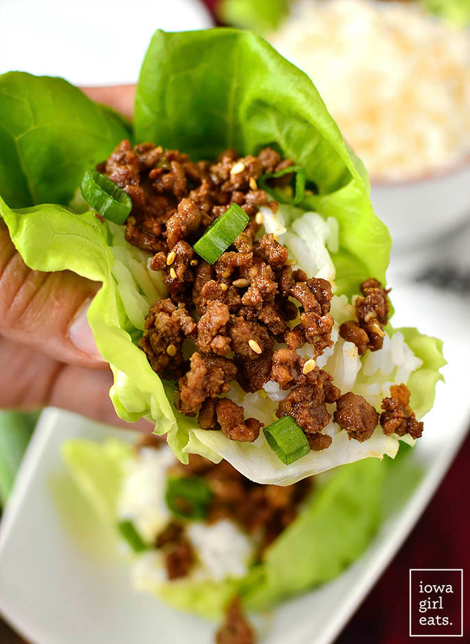 Hand holding Korean Beef lettuce cup made with ground beef