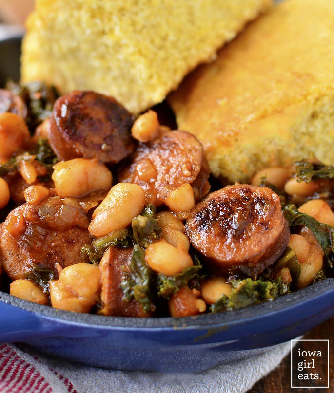 BBQ Sausage, Beans and Greens is an easy gluten-free dinner recipe that calls for just 7 ingredients, and is packed with protein, vitamins, and minerals. | iowagirleats.com