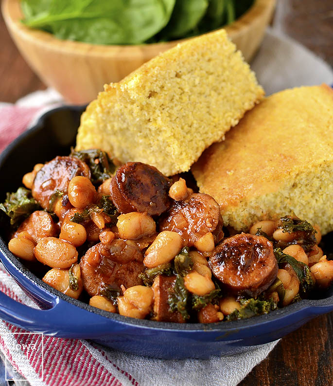 Skillet BBQ Sausage, Beans and Greens will be on the table in under 30 minutes. This easy,gluten-free dinner recipe calls for just 7 ingredients and is packed with protein, vitamins, and minerals! | iowagirleats.com