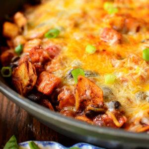 featured image of black bean and sweet potato enchilada skillet