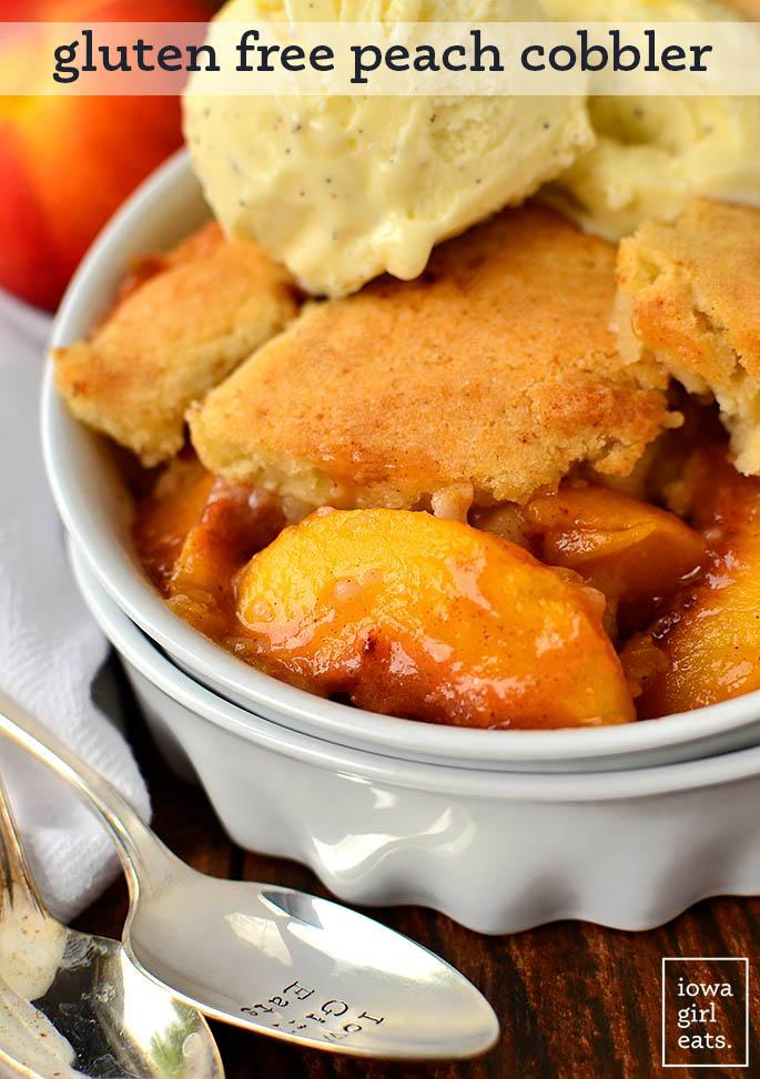 big scoop of gluten free peach cobbler in a dish