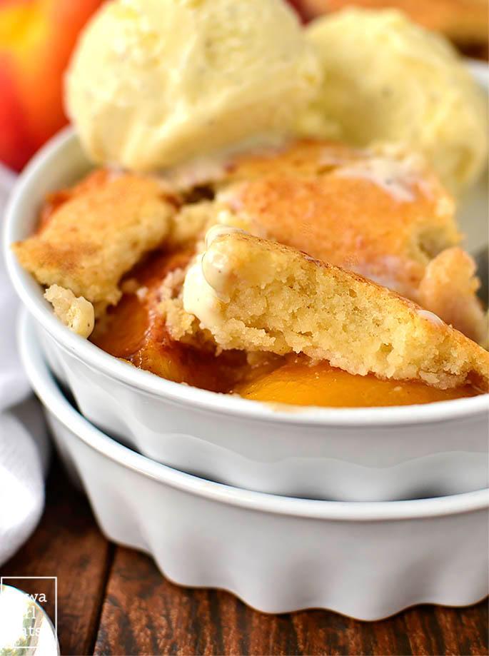 fluffy cobbler topping of gluten free peach cobbler in a bowl