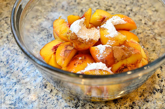 gluten free peach cobbler ingredients in a mixing bowl