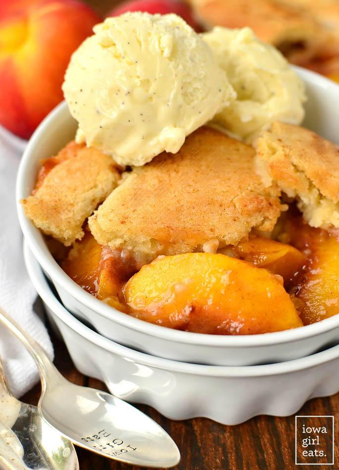 gluten free peach cobbler in a bowl with ice cream